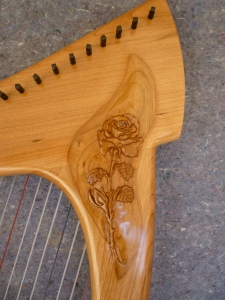 Rose carved into Oriel 23 Round Back Travel harp.
