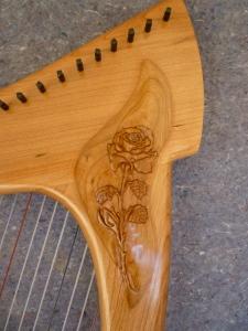 Rose carved into Oriel 23 Round Back Travel harp.